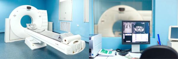 Мультиспиральный компьютерный томограф и процесс исследования, изображенный на экране компьютера специалиста
